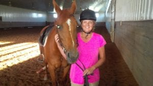 head vision therapist with her horse