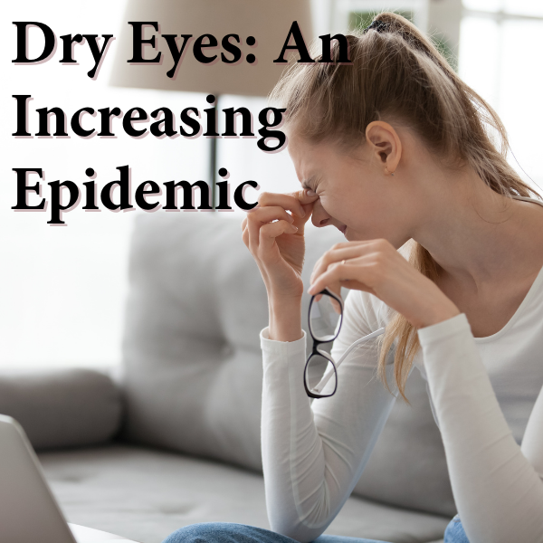 girl rubbing her dry irritated eyes